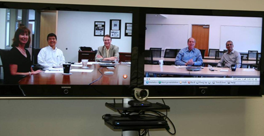 People participate in a LifeSize videoconference