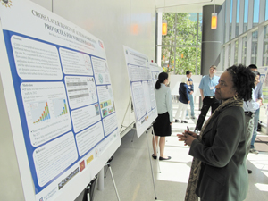 Deborah Jackson, ERC Program Director, looks at CIAN students' posters