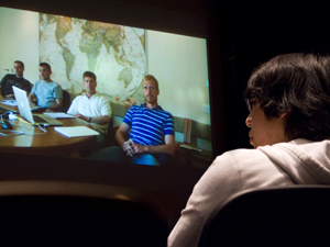 A student participates in a videoconference between UCSD and the National Geographic Society at Calit2's Atkinson Hall Auditorium.