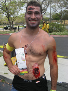 Disaster drill victim with fake wounds