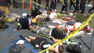 First responders conduct triage manuevers during disaster drill.