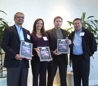 Ramesh Rao (left) and colleagues accept awards for UCSD Calit2 project
