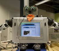 When the Machine Perception Lab robot called RUBI sees a child smiling, she giggles and encourages t