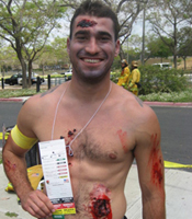Disaster drill victim with mock wounds