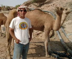 Tom Levy in the field, with camel
