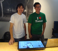 UCSD PRIME students, Lance Castillo and Wesley Hsu, show off the touch screen interface display.