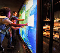A distributed architecture on Interactive displays allows nearly real-time collaboration for multipl