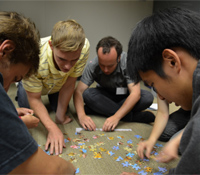 Summer scholars complete a puzzle together