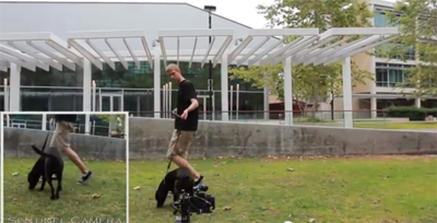 Calit2 researcher and canine friend testing camera trap outside UC San Diego's Atkinson Hall.