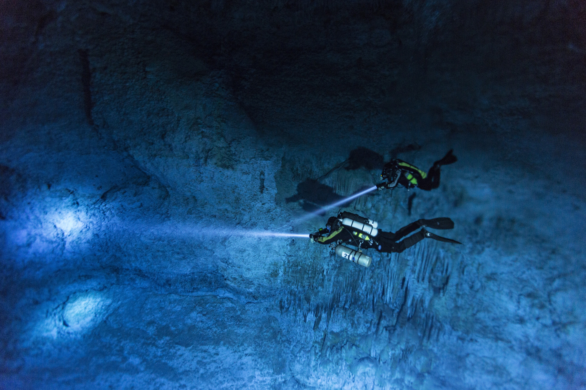 "Divers Susan Bird and Alberto Nava search the walls of Hoyo Negro, an underwater cave on Mexico's Yucatán Peninsula where the remains of ""Naia,"" a 12,000- to 13,000-year-old teenage girl, were found."