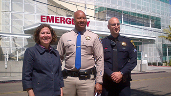 From left, Dr. Linda Hill, Capt. Rich Stewart and Detective Brian MacPherson.