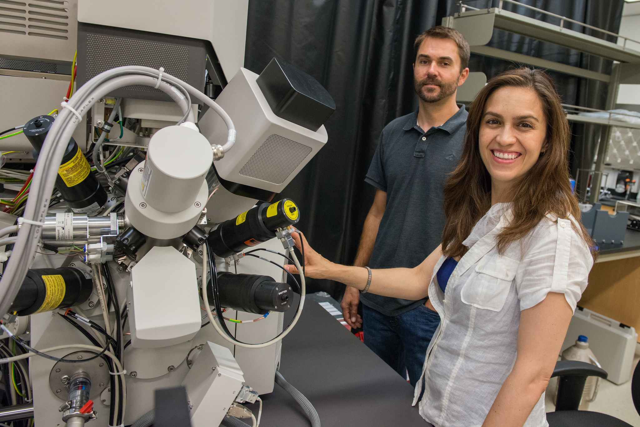 Nano3 Process Engineer Ryan Anderson and Assistant Professor of Biology Elizabeth Villa with the Scios microscrope