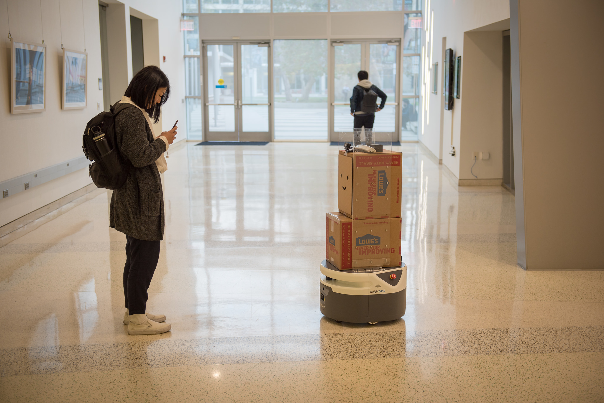 A student interacts with BoxBot