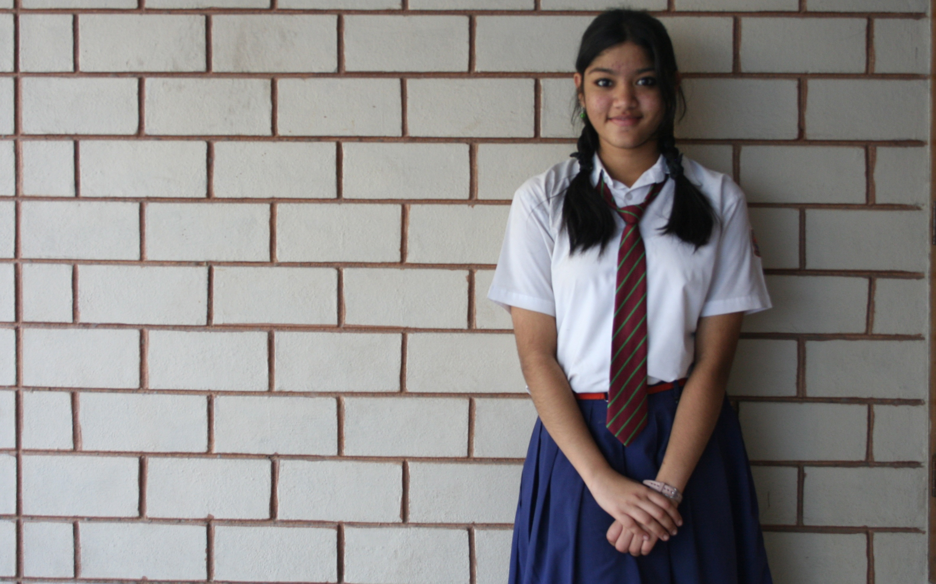 Schoolgirl standing and smiling