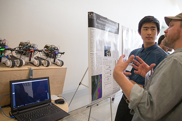 Music Ph.D. candidate Colin Zyskowski demos his networked robots at the Southern California Robotics