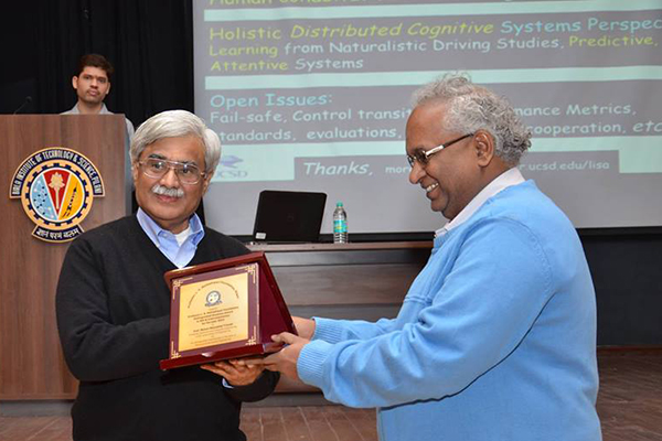 ECE Prof. Mohan Trivedi (front left) accepts alumni award from BITS Pilani, his alma mater.