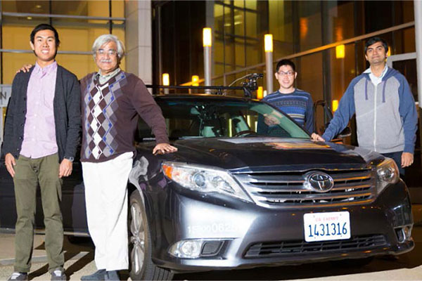 ECE Prof. Mohan Trivedi (second from left) with grad students and Toyota test vehicle.