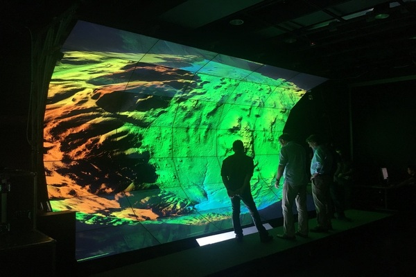 Researchers looking at WAVE visualization display