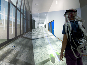 Kezeli makes his way through the unambigious rendering of the New Media Arts Wing at Atkinson Hall.