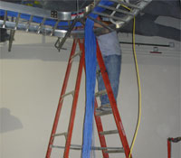 Installing cable from ladder