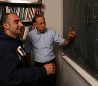 Professor Larry Milstein (right) with grad student Matteo Sabattini