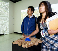 Students play with the Scalable City in the gallery@calit2