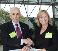 UCSD research vice chancellor Sandra Brown and Arthur C. Clarke Foundation chair sign agreement on n